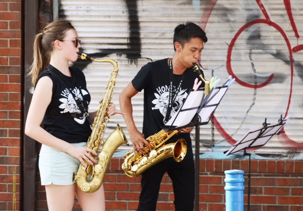 two saxophone players, hinkers group, at outdoors performance