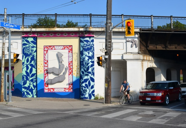part of a railway overpass has been painted with street art