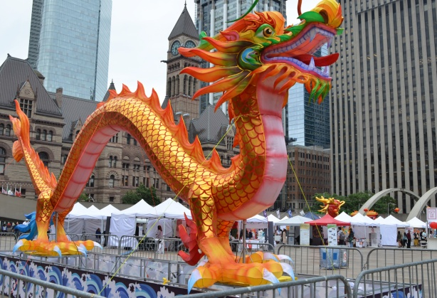 large and colourful inflatable dragon in front of city hall, at Nathan Phillips square, for dragon festival