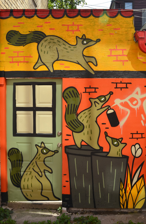 raccoon mural by Mily May Rose, raccoon on top of garbage cans, climbing on roofs, spray painting, inside garbage bins