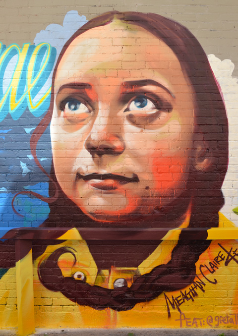 mural in an alley, large portrait of Greta Thunberg, the Swedish teenager advocating for action on climate change, painted by Meaghan Claire Kehoe