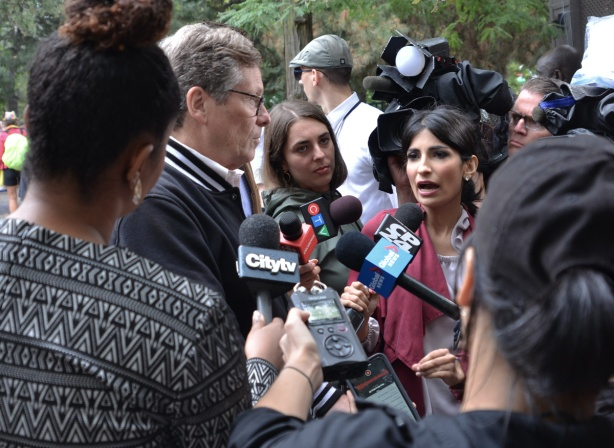 Toronto mayor John TOry being interviewed by the media at a pro-Pride rally at Barbara Hall Park, City TV, CP 24, CTV and Global News were among the media.