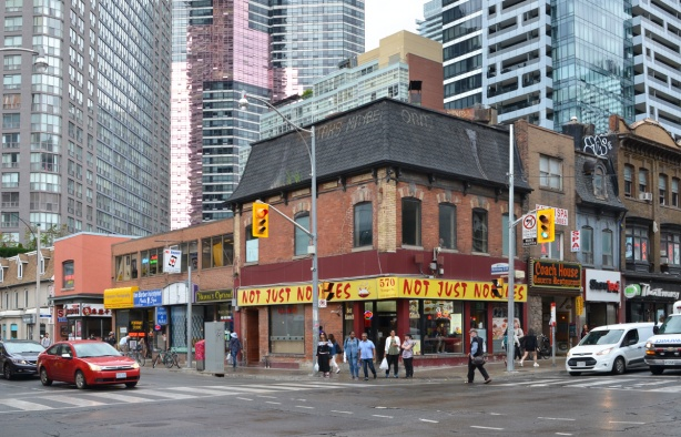 northwest corner of Yonge & wellesley, old brick buildings on Yonge with newer taller condos behind - Not Just noodles restaurant