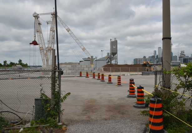 black and orange cones line the route of entry to cement making facility in the Port lands