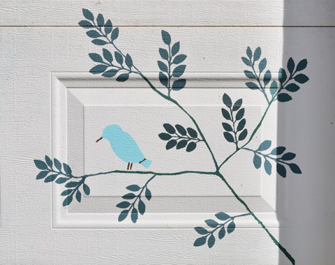 a simple painting of a blue bird on a branch of leaves