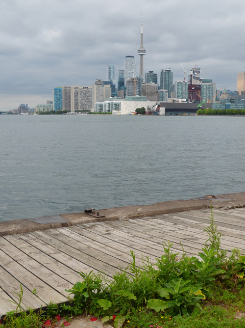 view of Toronto skyline across Toronto Harbour from Polson Pier