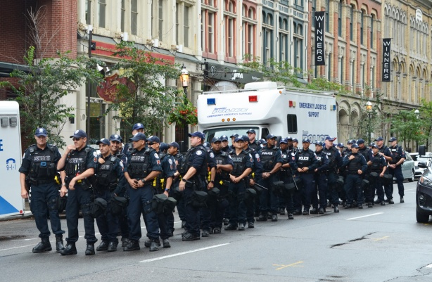 member of p s u , public service unit, wait on Front Street in case they are needed at protest