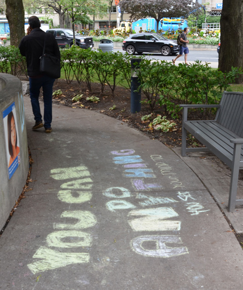 chalk words on a concrete path in a park that say you can do anything