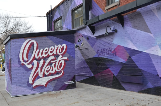 purple and black abstract street art mural on exterior of building at Queen West and Denison