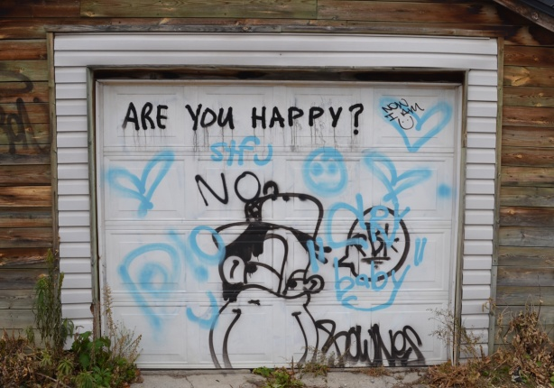 a garage door with the words, are you happy?