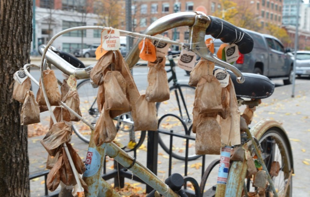 close up of bike decorated with many used tea bags