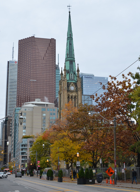 King street east,, looking west from Jarvis Street towards steeple of St. James Cathedral and the trees in front of it in autumn colours