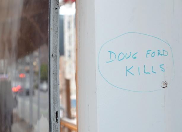 in blue marker, graffiti that says Doug Ford kills