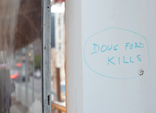in blue marker, graffiti that says Doug Ford kills