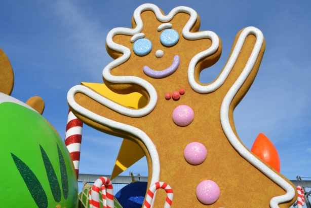 large gingerbread man sculpture on parade float