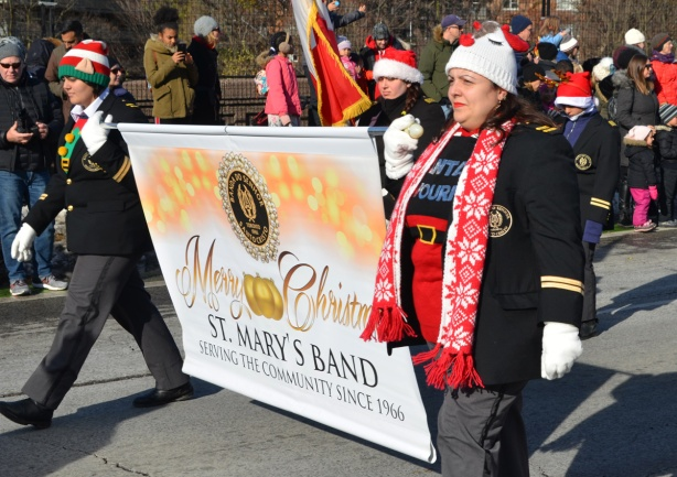 woman holding the end of a banner for St. Marys Band
