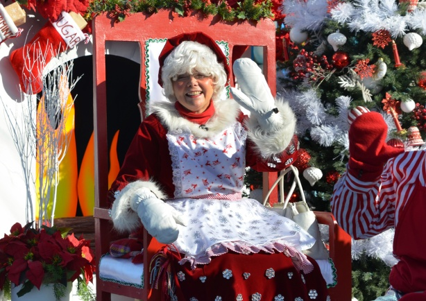 float in Santa Claus parade with Mrs. Claus waving