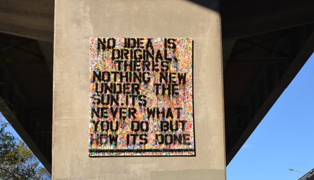 a painting on a concrete pillar of an overpass, words, No idea is original there's nothing new under the sun, it's never what you do but how you do it.