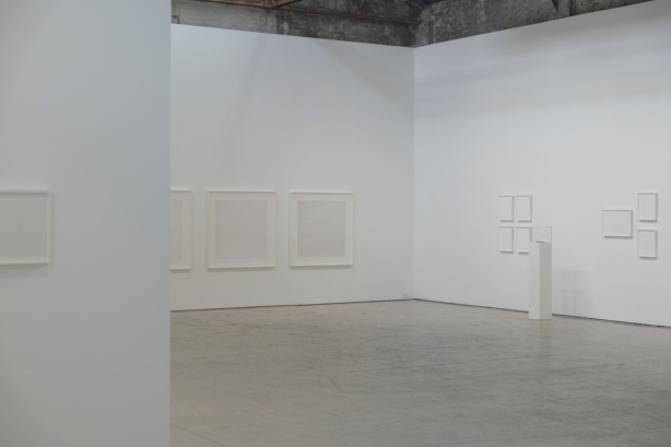 art on the walls of a gallery, all frames are white, the artwork is all very pale