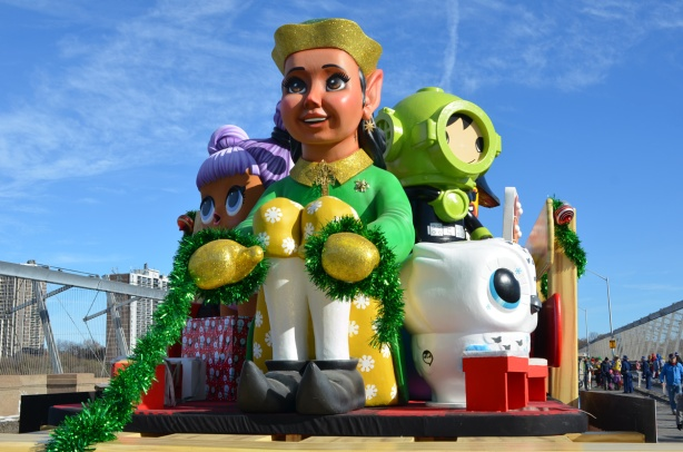 large toys, shapes of toys, on a float in the Santa Claus parade