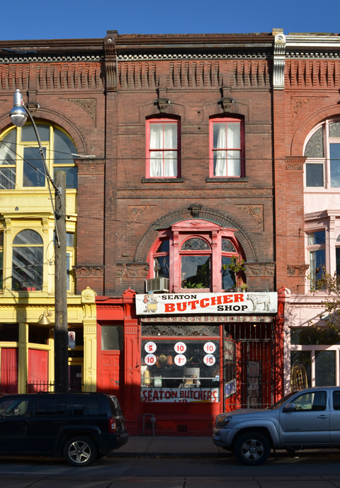 Seaton Butcher shop exterioe, old brick building, red trim, Queen Street East