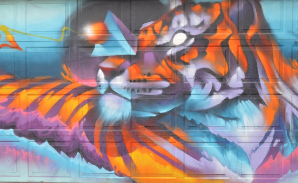 partially abstract painting of a tiger by luvsumone, xyz