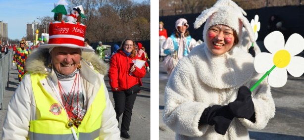 two women walking in Santa Claus Parade, picture on left is older woman with a fancy Happy Holidays hat, picture on right is woman in white fuzzy sheep costume holding a large yellow and white daisy