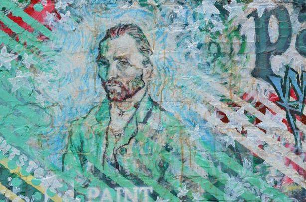 a portrait of Vincent Van Gogh on an exterior wall, street art mural