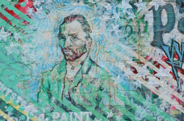 a portrait of Vincent Van Gogh on an exterior wall, street art mural