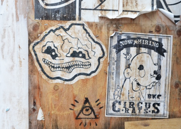 old weathered pasteups on a piece of plywood