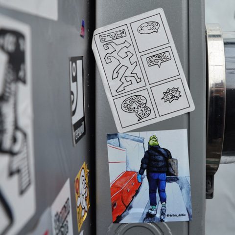 two stickers on metal, the lower one is by drible drible