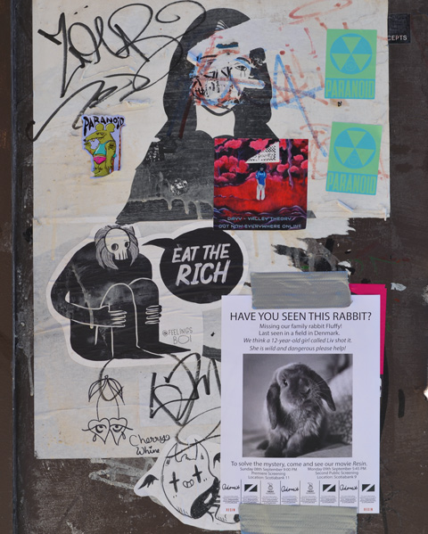 paste ups and posters on a wall