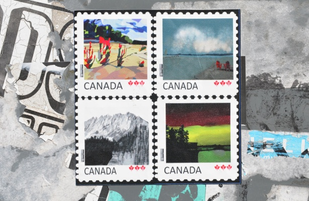 graffiti, or street art, in the shape of 4 Canada postage stamps, each one with a different nature scene