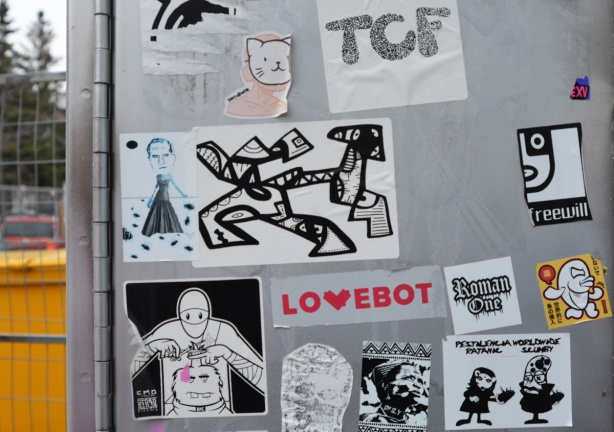 stickers and slaps on a grey metal box