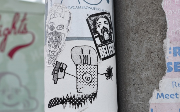 stickers and slaps on a pole