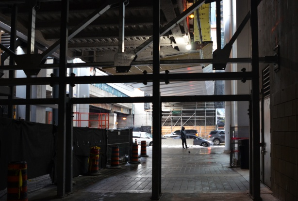 from the inside, looking out, construction of the new exit, and new elevated walkway to building being constructed across the street
