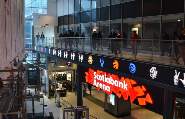 interior, Scotiabank Arena people on elevated walkway between Waterpark Place and Scotiabank Arena