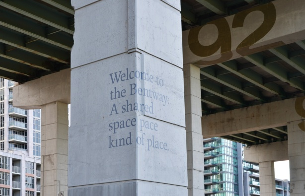 the bentway, the new development and park under the gardiner expressway, words on one of the concrete posts that says Welcome to the Bentway a shared space kind of place