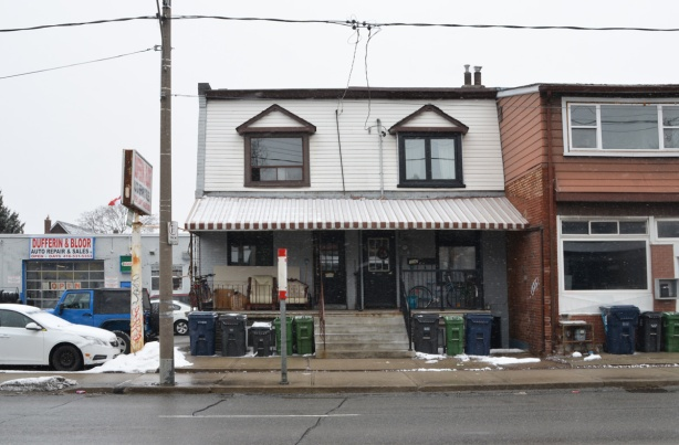 two storey semi divided house beside Dufferin Bloor auto shop, bus stop in front,