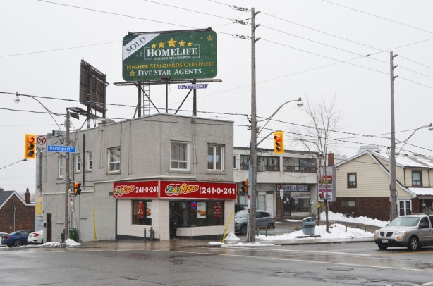 south west corner of Dufferin and Davenport, pizza restaurant with large billboard on the roof