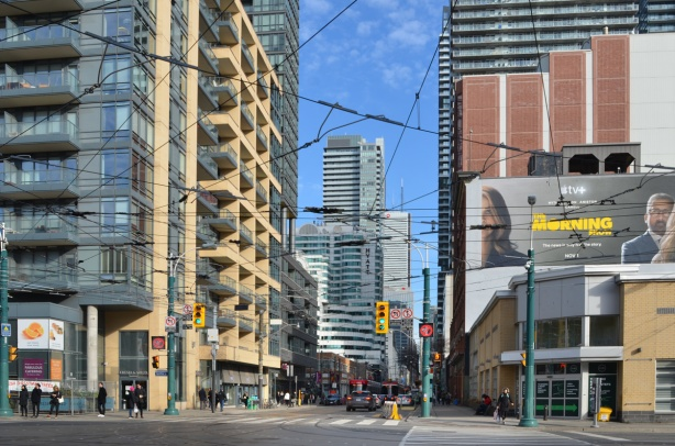 looking eastward along King St from Spadina, high rises, billboard, traffic, city,