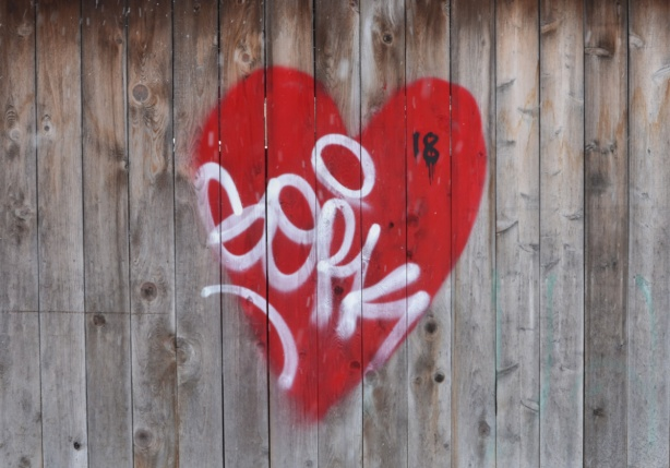 graffiti, red heart on a wood fence
