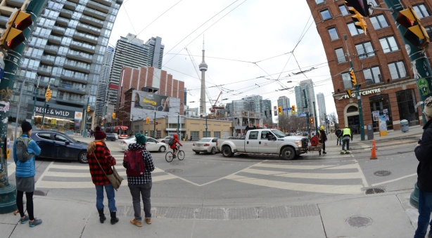 two young women standing on the corner of King & Spadina