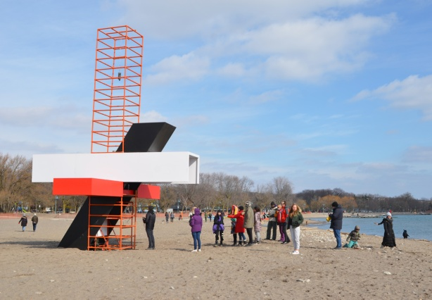 people lined up to take a look inside a portion of art installation at Woodbine Beach