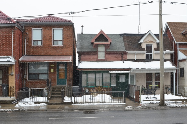 three houses on Dufferin, the one on the left is 1452A