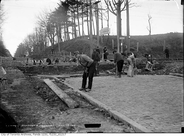1912 black and white photo of construction of Dufferin, cobblestones or bricks, at Davenport