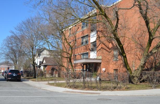 4 storey apartment building, brick, on a corner