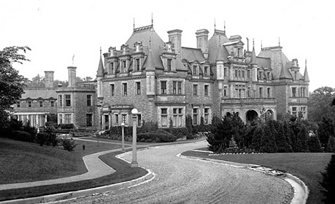 old black and white picture of a mansion, Chorley Park, stone, long curving driveway, three storeys, many chimneys,