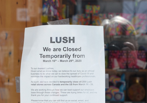 poster sign on door of Lush store explaining why they are closing