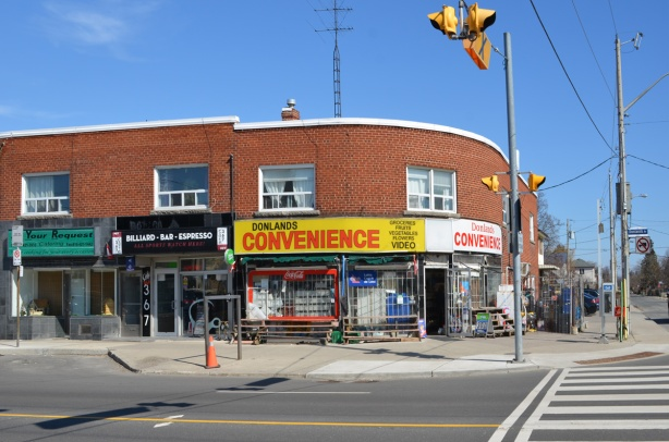 Donlands convenience store, a 2 storey brick building on the corner of an intersection, with a rounded wall
